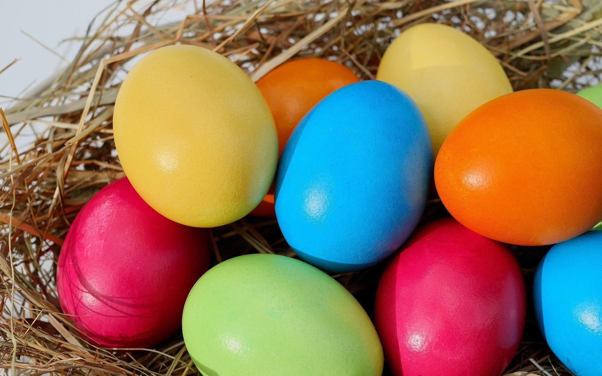 Painting eggs on hay